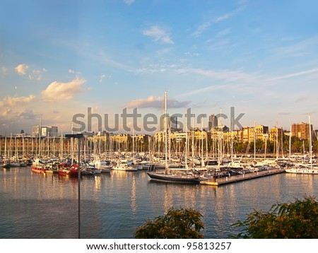 Some boats in  Barcelona port at the sunset