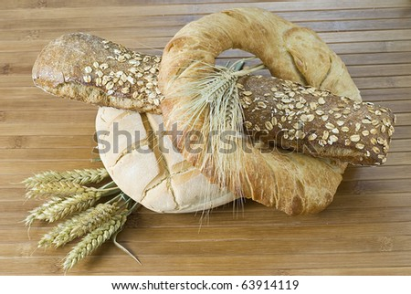 Some bread and cereals on a bamboo mat.