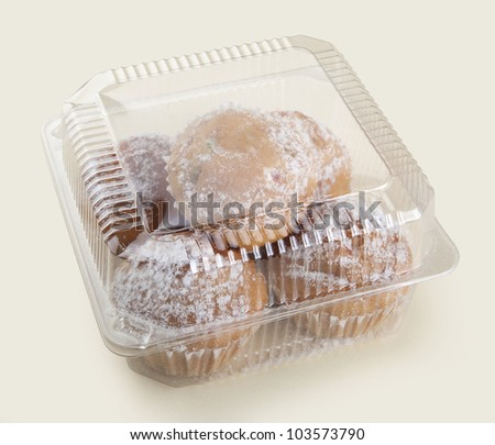 Some cakes in the plastic box