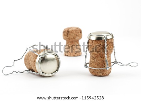 Some champagne corks close-up on white background