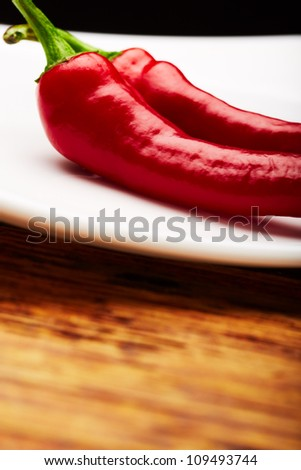 some chili peppers on a plate
