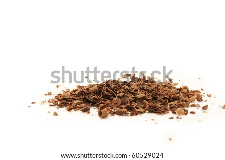 some chocolate crumbles on white background