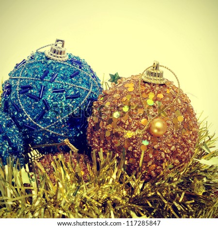 some christmas balls and golden tinsel with a retro effect