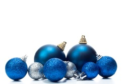 some christmas balls on a white background