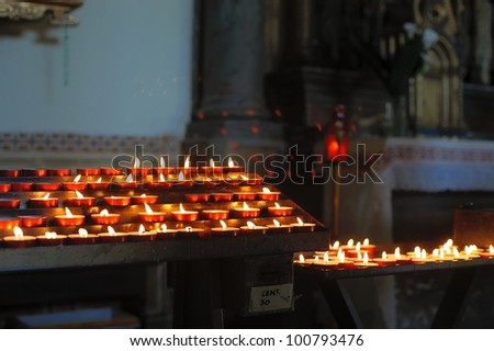 Some church candles against a dark background
