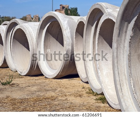 Some concrete tubes in the ground. Construction concept