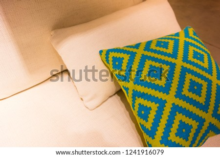 some cozy pillows on a cozy sofa in an apartment #1241916079