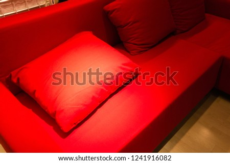 some cozy pillows on a cozy sofa in an apartment #1241916082