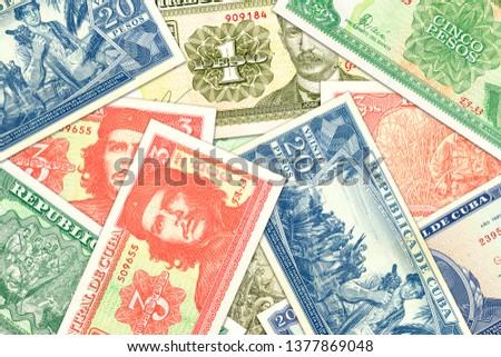 some cuban peso banknotes indicating growing economy #1377869048