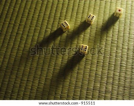 "Some dice and shadows on a tatami floor-abstract for ""hazardous Japan""."