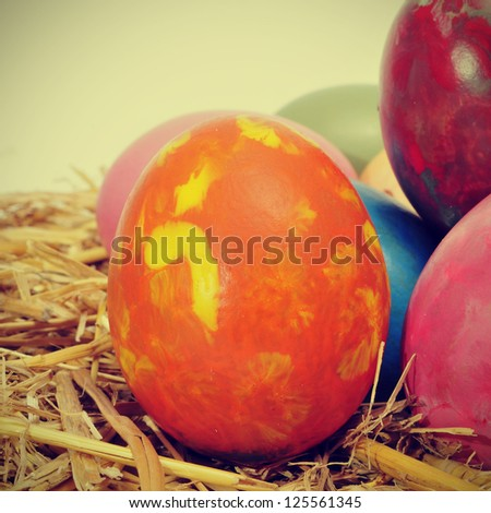 some easter eggs of different colors on a nest, with a retro effect