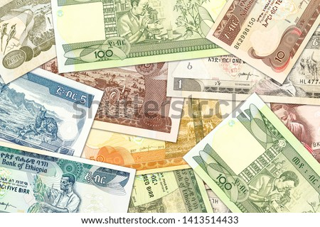 some ethiopian birr banknotes illustrating growing economy and investment #1413514433