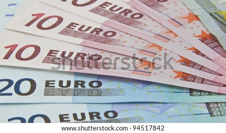 some euro bank notes fanned out on display