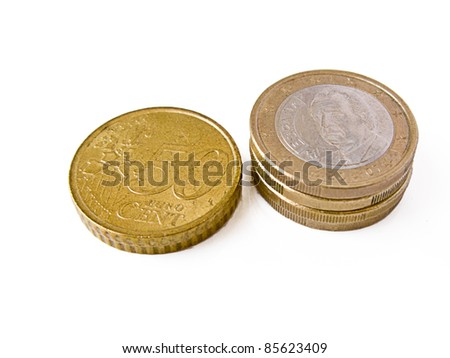 Some euro coins in piles: 50 cents pile and one euro pile