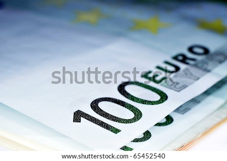some 100 euros bills on a white background
