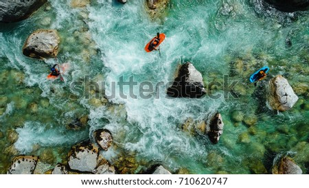 Some extreme whitewater Kayaker paddling on the Emerald waters of Soca river, Slovenia, are the rafting paradise for adrenaline seekers and also nature lovers, aerial view.