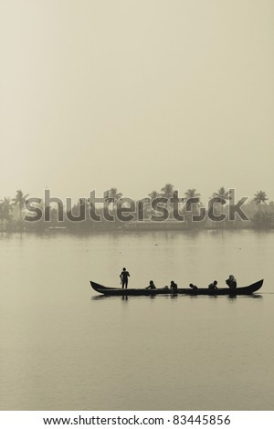 Some fishermen on a boat in Kerala, India.