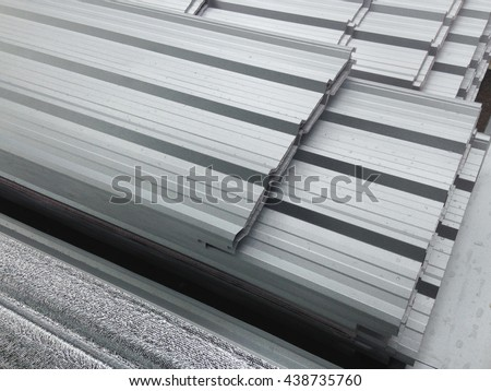 Some focus of water on metal sheet roof, Reflect light on metal sheet roof, Silver color Metal Sheet roof