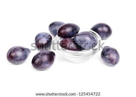 Some fresh blue plums on the white background