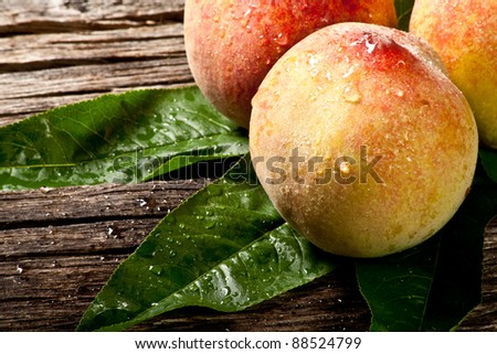 some fresh withe peaches with leaf on wood - stock photo