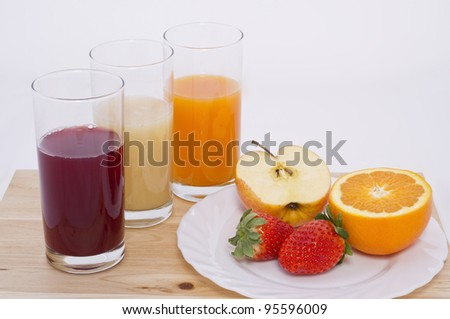 Some glass with juice of different fruit in white background