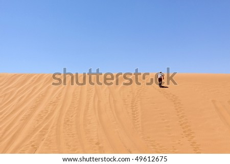 some guy is running up the dune