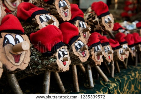 some handmade tio de nadal, a typical christmas character of catalonia, spain, on sale in a christmas market Zdjęcia stock ©