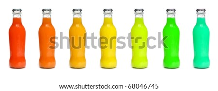 some juice bottles of different colors on a white background