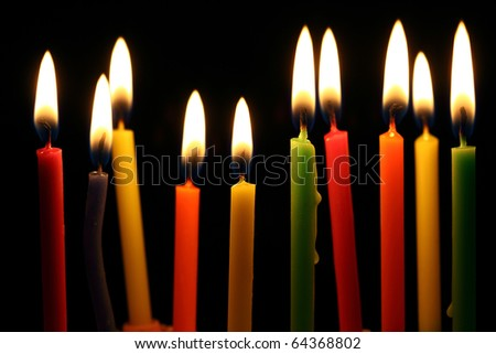 Some lit birthday candles close up