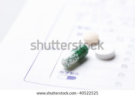 Some medicine on the medicine paper bag.