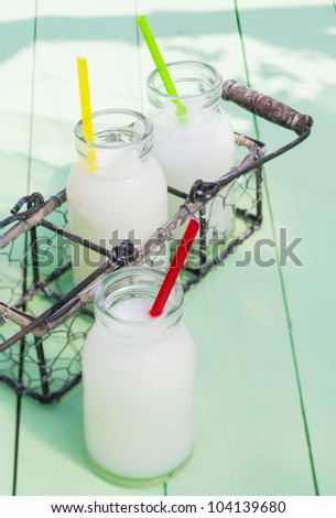 Some milky drinks in a tray for lunch time outdoors