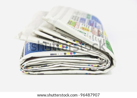 some newspapers folder up on white background - stock photo