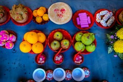 Some of food offering seen on the table for an unseen spirit at the Hungry Ghost Festival.