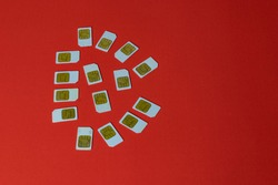 Some old Sim Cards on red background. With space for text.