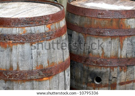 Some old wooden barrels with metal bands