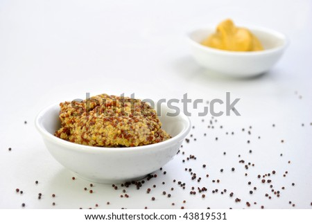 some organic mustard in a white bowl