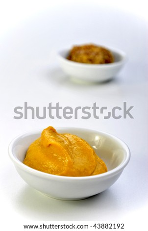 some organic mustard in a white bowl - stock photo
