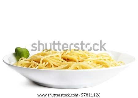 some pasta on a plate with basil on white background