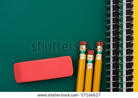 Some pencils and scribbler on a chalkboard , School Days