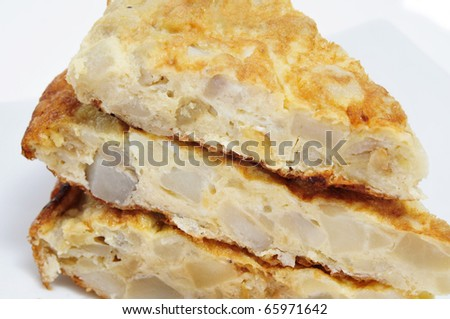 some pieces of typical spanish tortilla de patatas on a plate