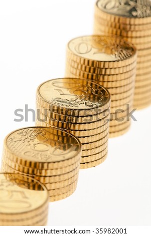 Some piles of euro coins on white background