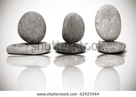 some piles of zen stones reflected on the background