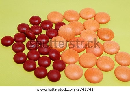Some pills in yellow background