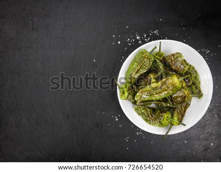 Shutterstock Some Pimientos de Padron on a slate slab as detailed close-up shot; selective focus
