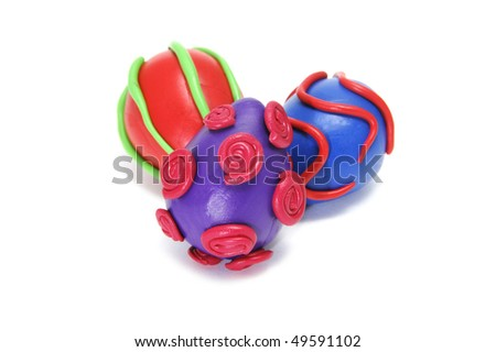 some plasticine easter eggs of different colors isolated on a white background