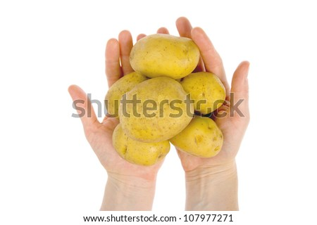 Some potatoes in hand isolated on white background