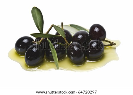 Some premium olives on olive oil isolated on a white background.