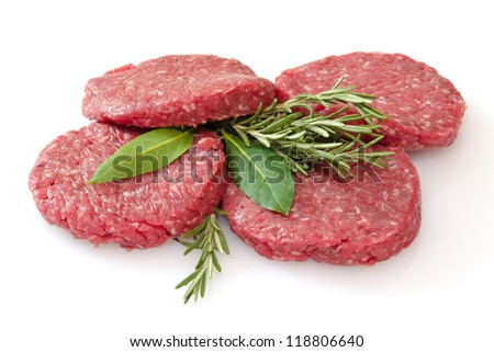 some raw hamburgers isolated on white background