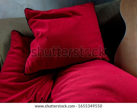 some red pillows on the sofa