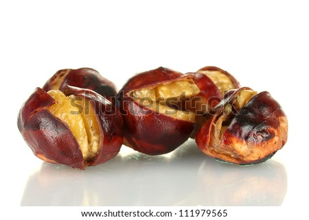 some roasted chestnuts isolated on white